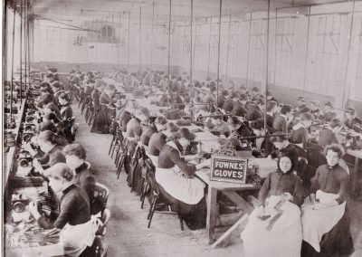 Rows of women sewing gloves at Fownes factory in Worcester.