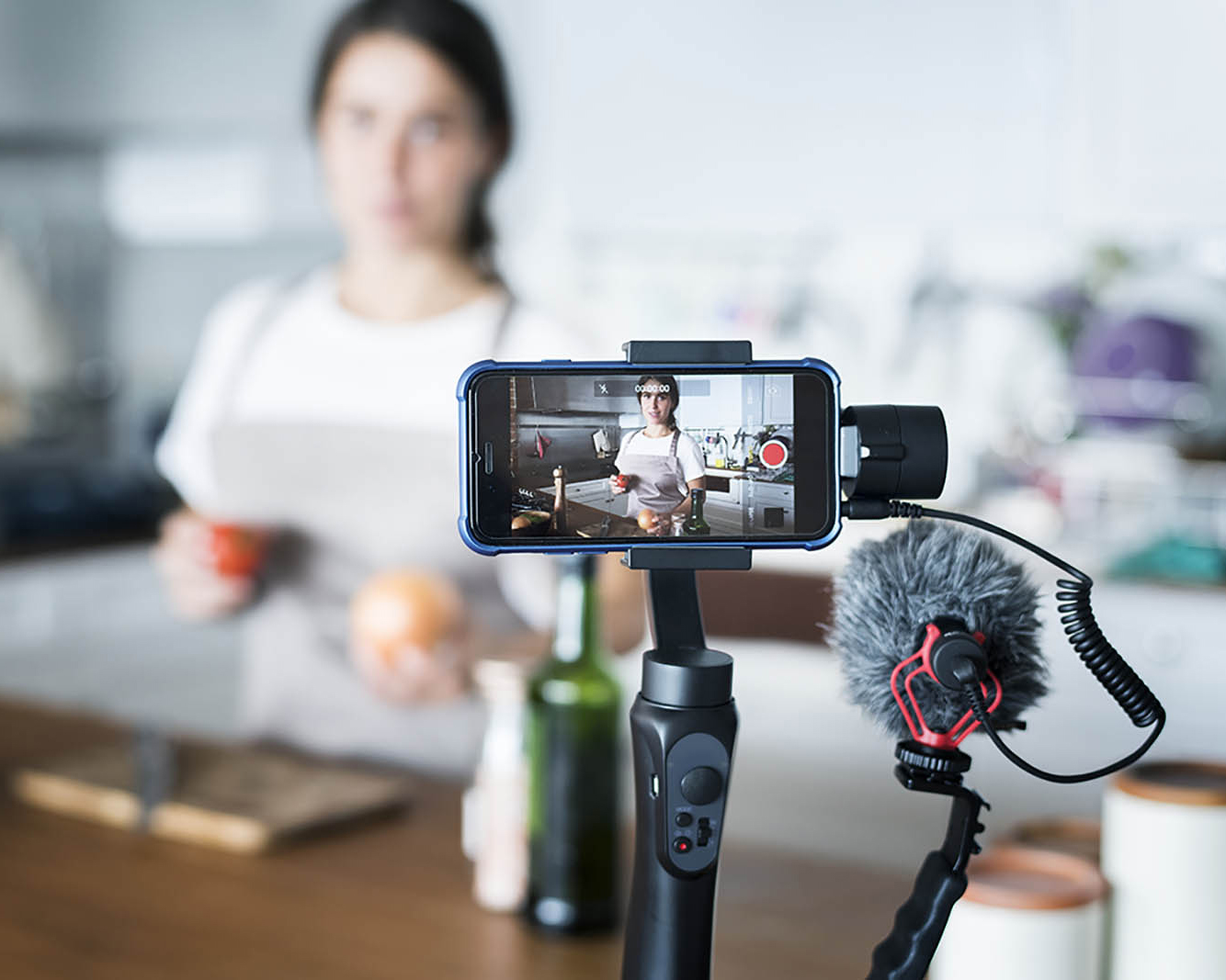 A phone videoing a young woman vlogger